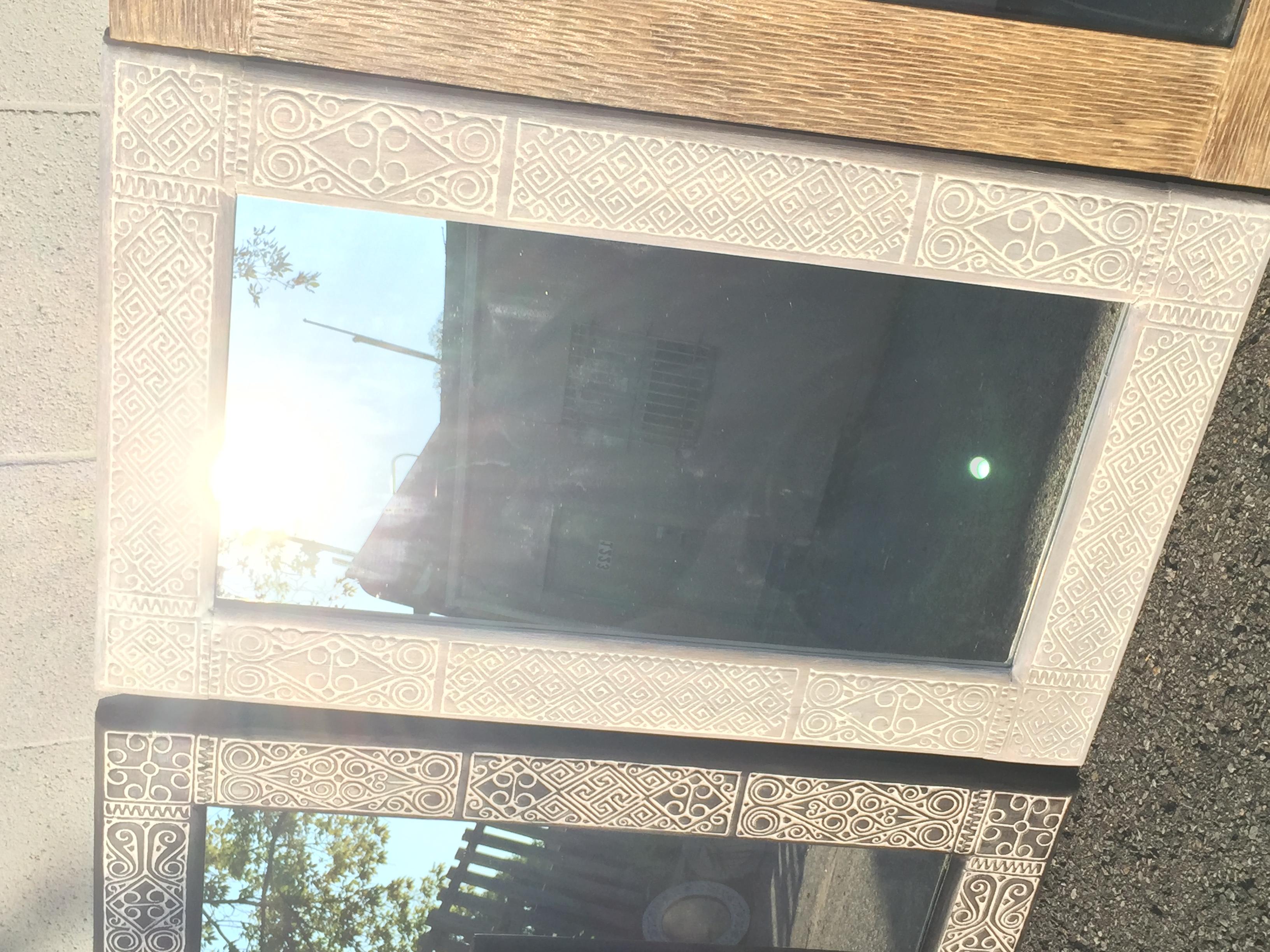 primitive carved mirror