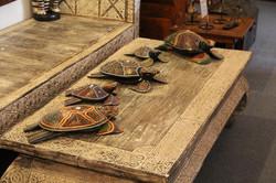 Various styles of carved Turtles