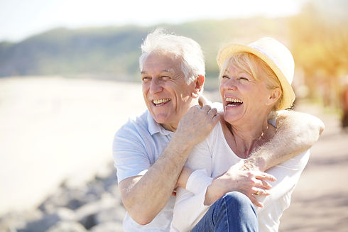 Senior couple relaxing by the sea on sun