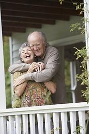 hugging senior couple