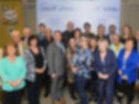 Dave Turcotte, député de Saint-Jean accompagné des 21 lauréats