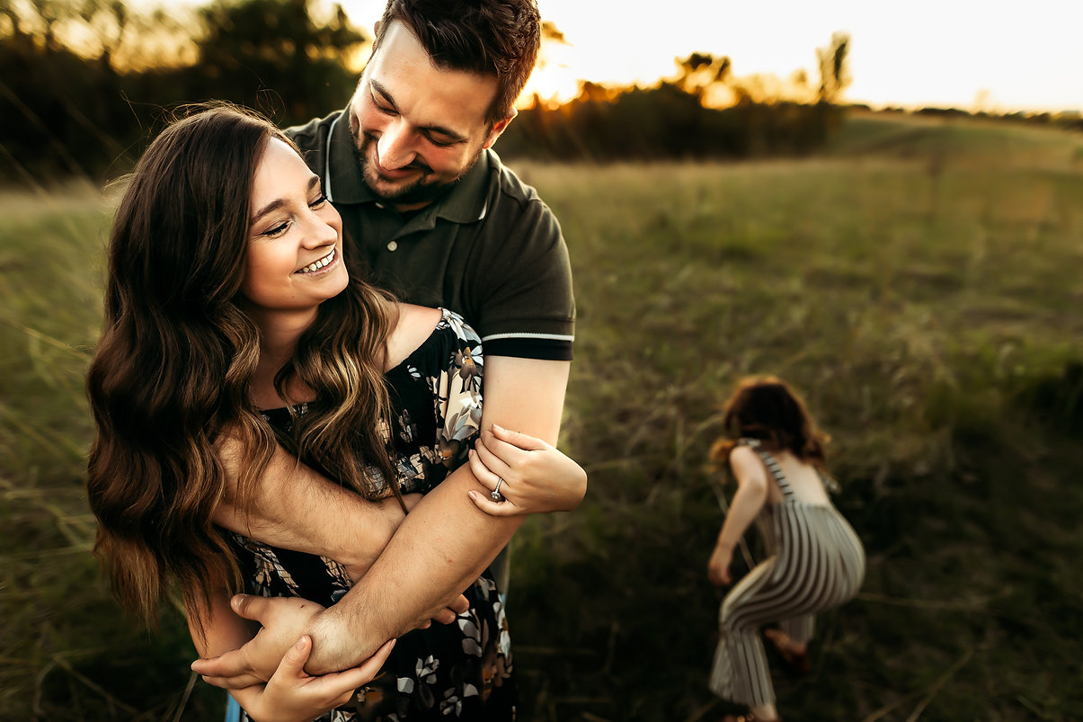 Owatonna family photographer couple laughing and hugging