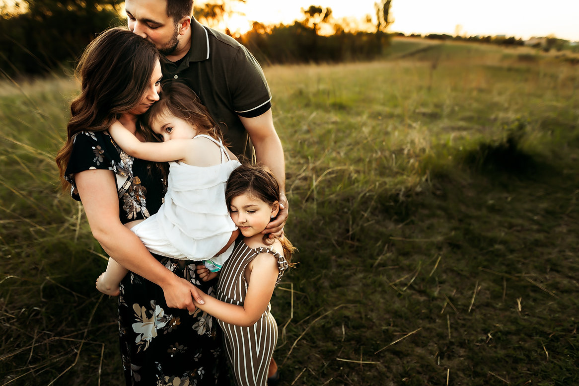Owatonna MN family photography family of four embracing in field