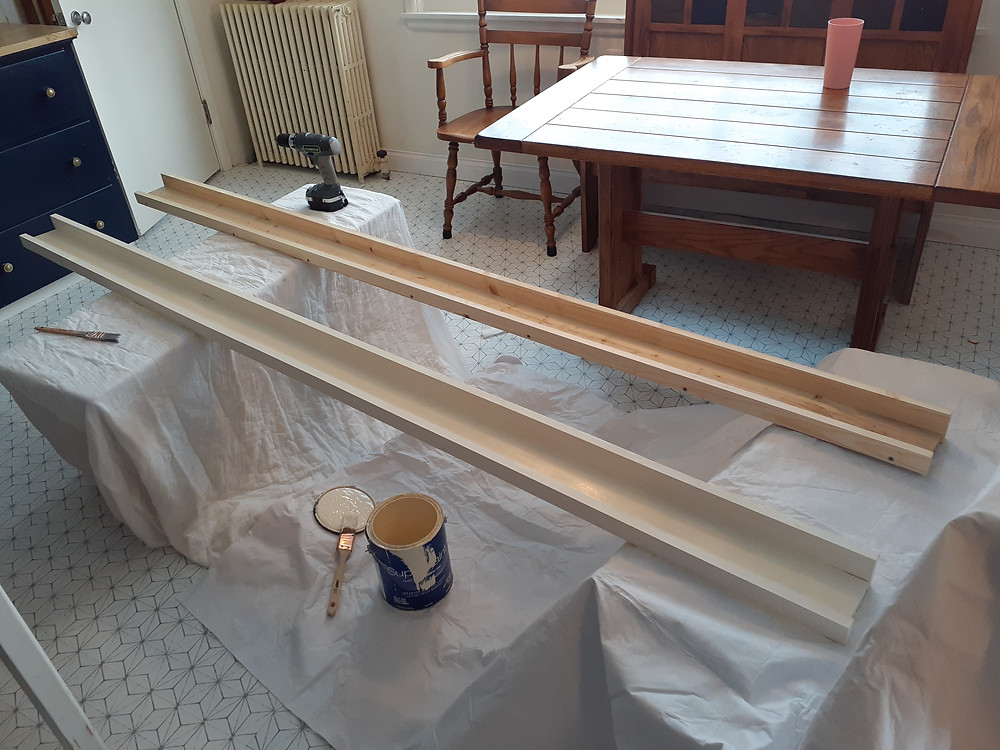 shelves being painted and constructed for gallery wall shelving