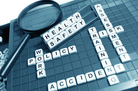 Scrabble board with the words health, safety, training, work, policy, accident, risk, and assessment spelled out