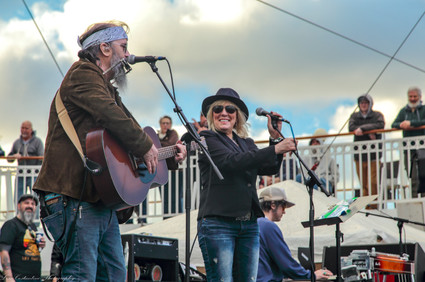 Lucinda Williams joins Steve Earle on the pool deck