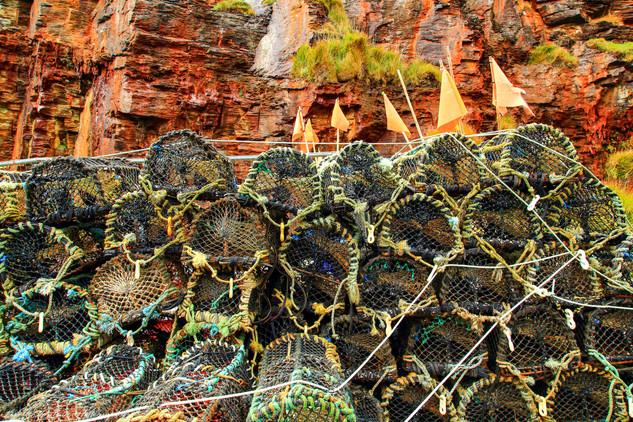 Crab pots against red cliffs, Boscastle