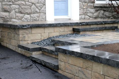 Interlock retaining wall, steps, porch; Rock garden