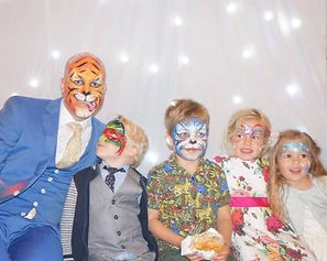 Face painted wedding guests