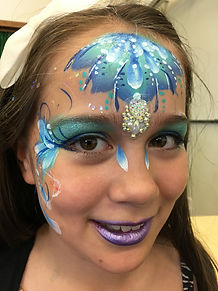 Blue and white face paint with gems