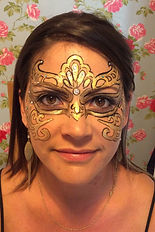 Gold face paint mask with gems