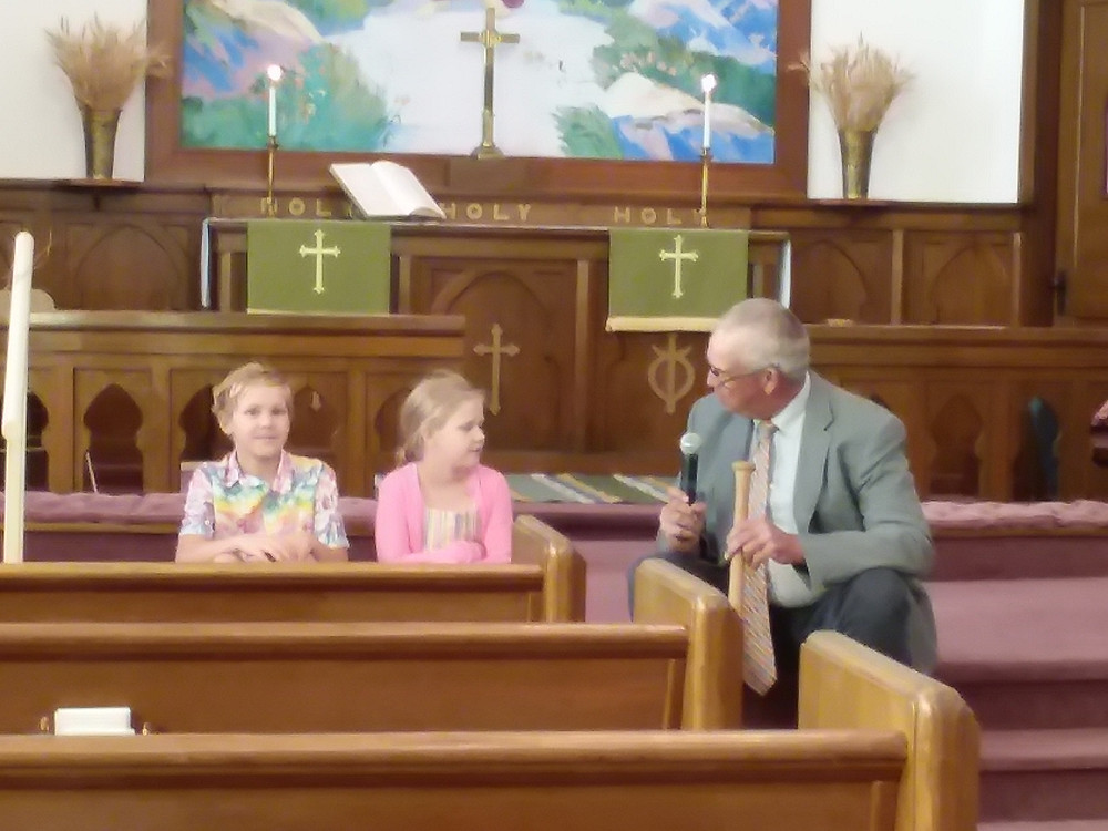 The Children's Sermon, delivered by Brad Shogren (on right). The two youth: Axel Walline (Left), and his sister, Eleanor (middle)