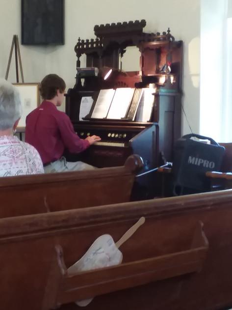 CJ playing music during service
