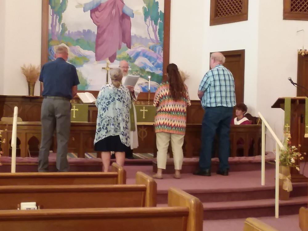 Teacher Installation Service. (L to R: Curtis Crandall, Janet Crandall, (Pastor Berggren), Amy Herzog, Dean Anderson, acolyte & liturgist Zach Gross