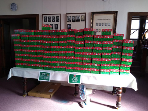 Shoeboxes stacked and ready to load