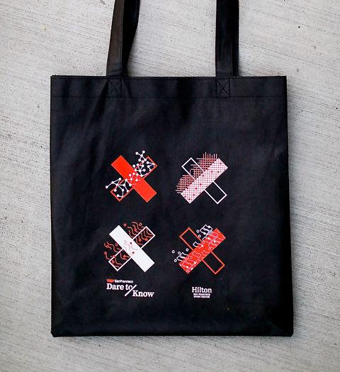 X graphics on a black tote bag