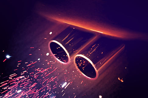 Close up of a double muffler, emitting sparks. I don't even know if that is realistically possible.