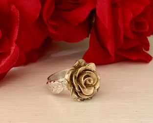 A Gold Rose Among The Red