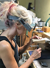 KCDesign Jewelry studio - sawing at the