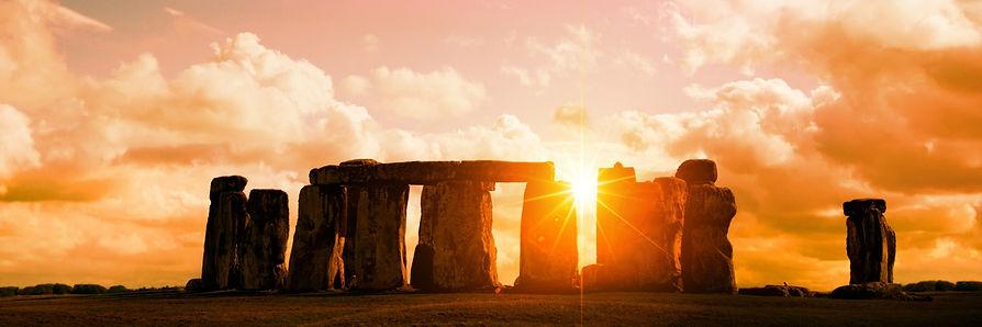 Sun shining through Stonehenge pillars