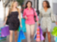 group-of-women-carrying-shopping-bags-on