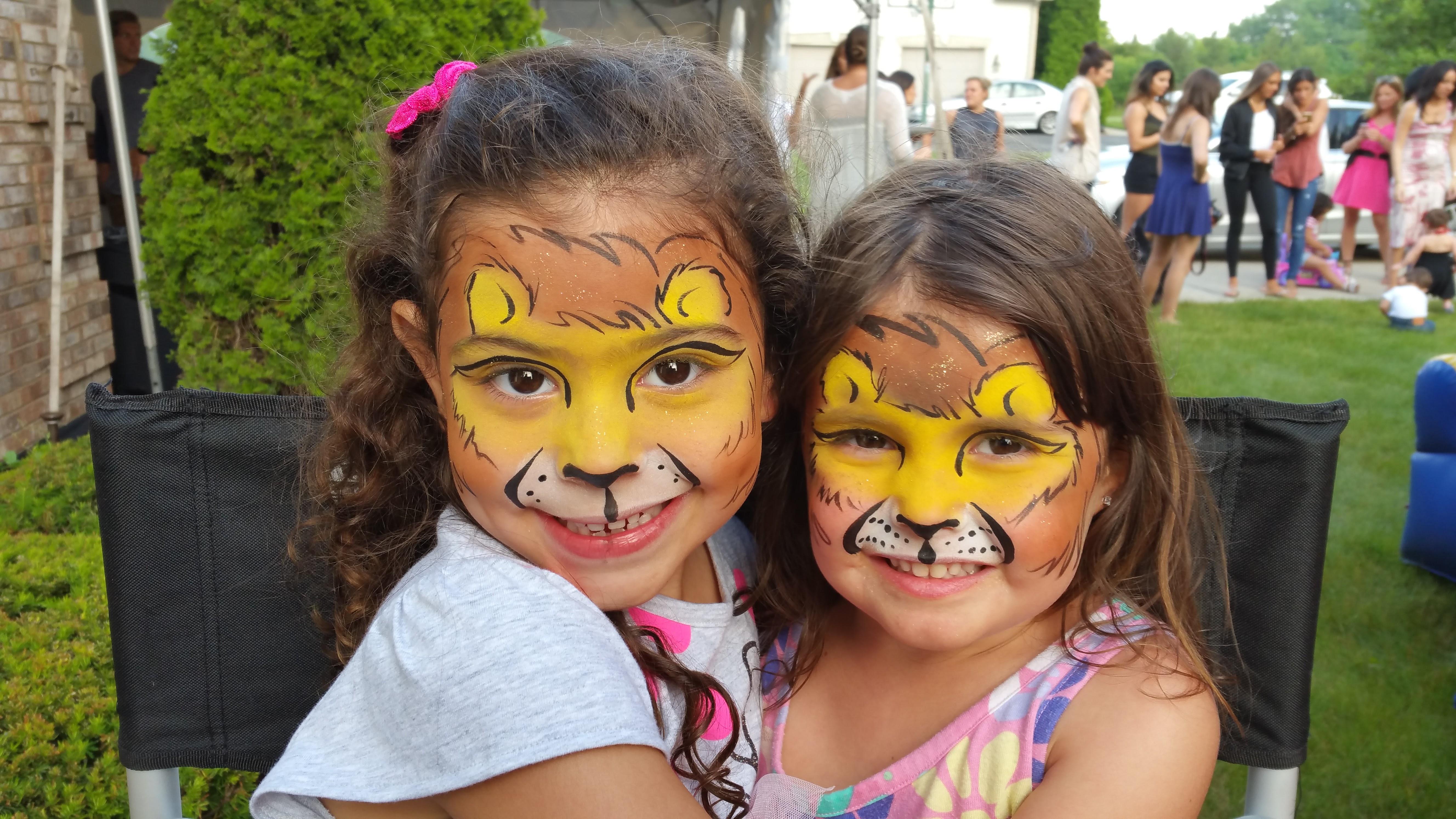 Lion face paint besties