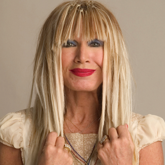 """Betsey Johnson is an American fashion designer best known for her feminine, whimsical, """"over the top"""" designs."""