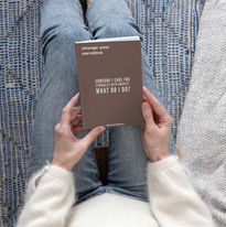 book-mockup-of-a-woman-in-a-cozy-setting