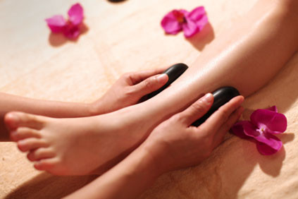foot massage with hot stone