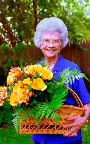 Woman holding flower basket.JPG