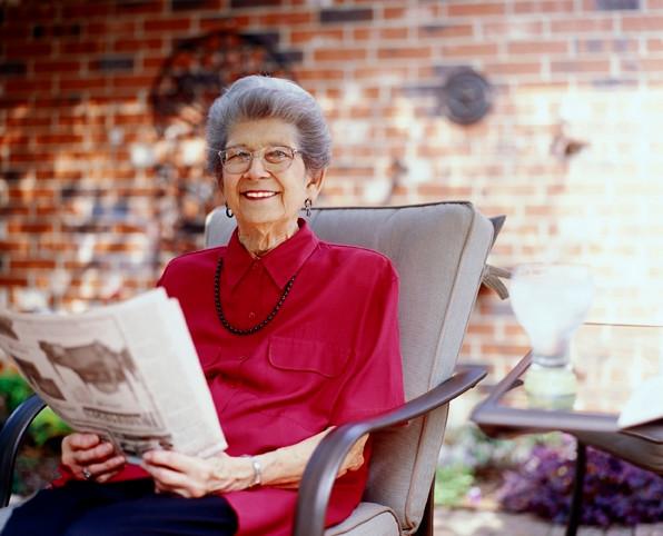 Older woman reading newpaper.JPG
