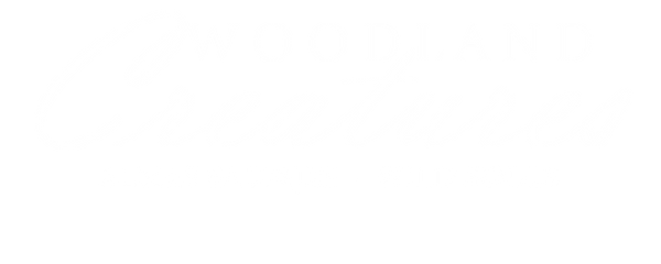 logoWoodlandCreaturesVerticalCompletoWEB