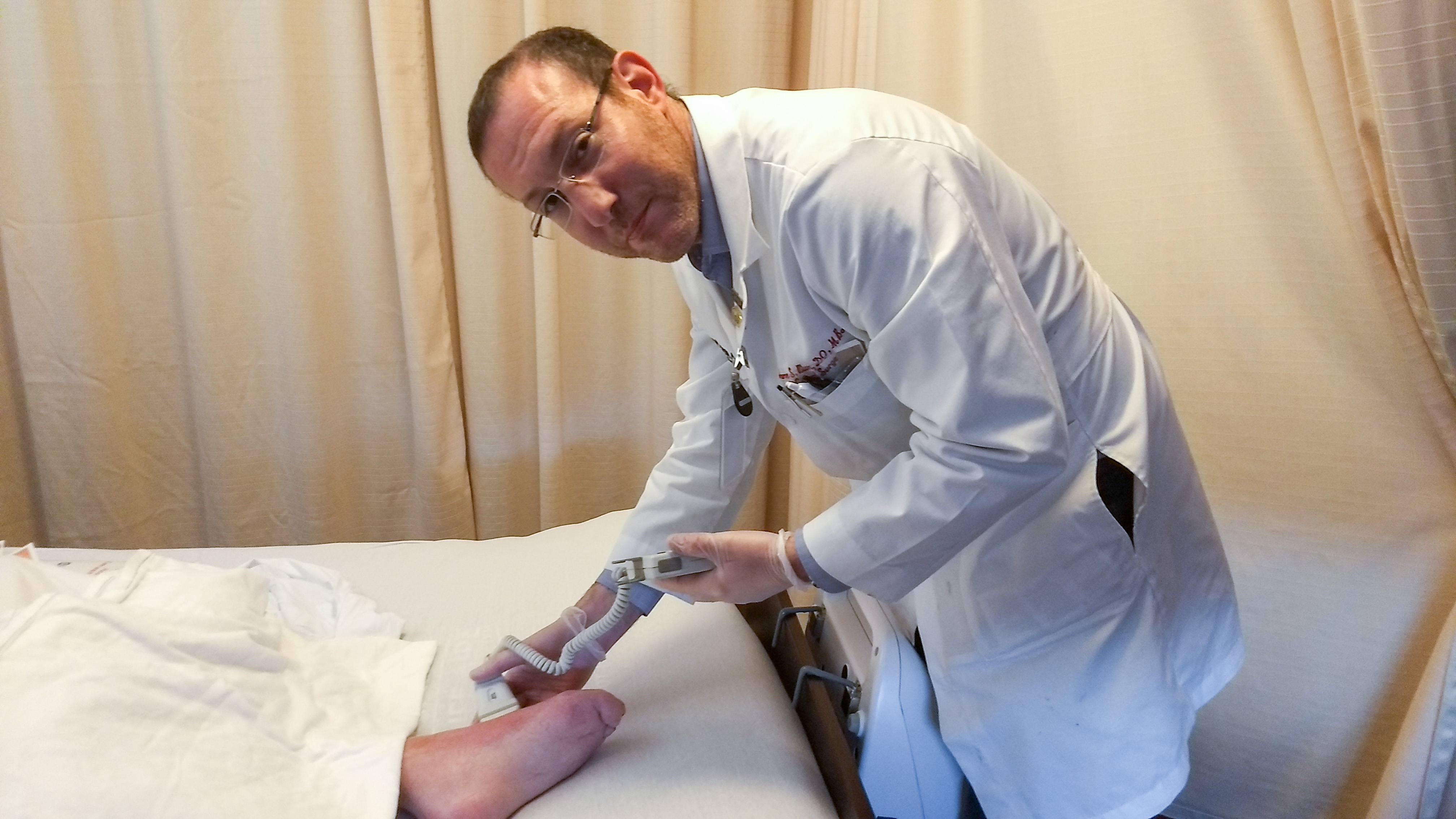 Wound care doctor treating a patient