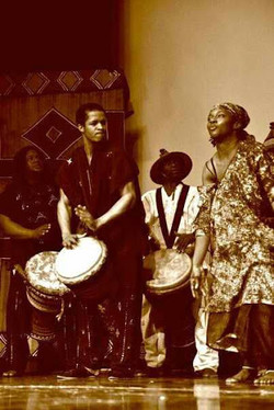 Playing djembe with Drum Call group