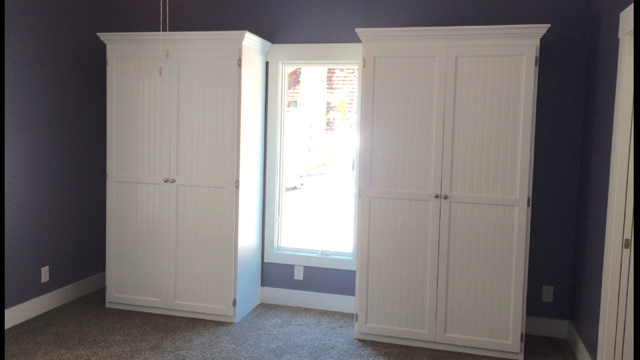two white painted murphy beds