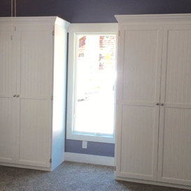 two single painted white murphy beds