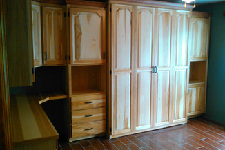 murphy bed with built in desk and cabinets