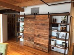 barn door murphy bed with shelves