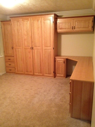 murphy bed with cabinets and built in desk