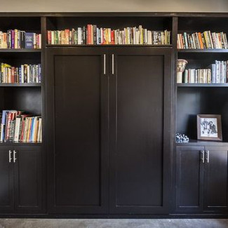 black painted murphy bed with side and top cabinets