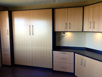 murphy bed with built in cabinets and counter