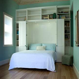 white painted murphy bed with top and side cabinets