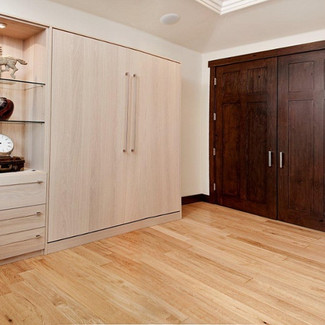 murphy bed with side cabinet and glass shelving