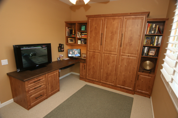 murphy bed with side cabinet and built in desk