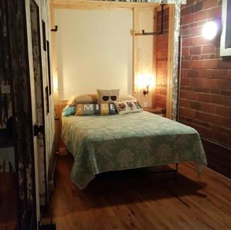 loft murphy bed with swinging barn door
