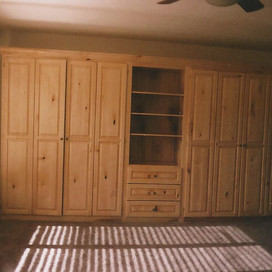 two full murphy beds sharing shelving