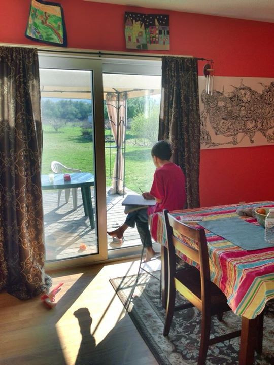 In this picture, my son is taking time to observe and reflect.  He ended up sitting and sketching scenes from our backyard's landscape.