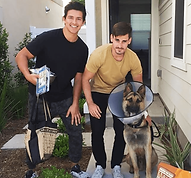 two men and dog.png