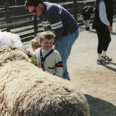 BABY JAMES WITH SHEEP.jpeg