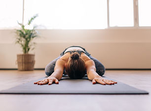 fitness-woman-working-out-on-yoga-mat-ro